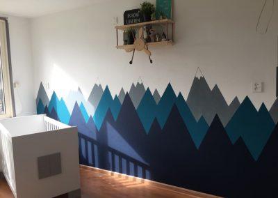 Muurschildering babykamer bergen