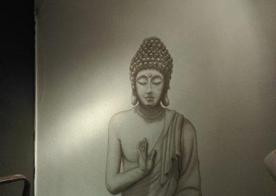 Muurschildering Boedda in welness ruimte