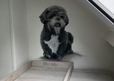 Muurschildering babykamer hondje
