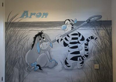 Muurschildering babykamer winnie de pooh strand