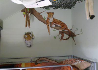 Muurschildering tijgers en leeuwen