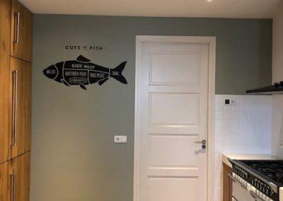 Muurschildering vis in keuken