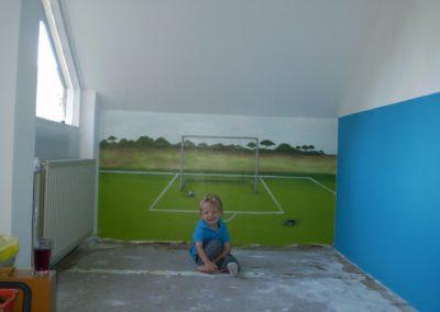 Muurschildering kinderkamer voetbalveld